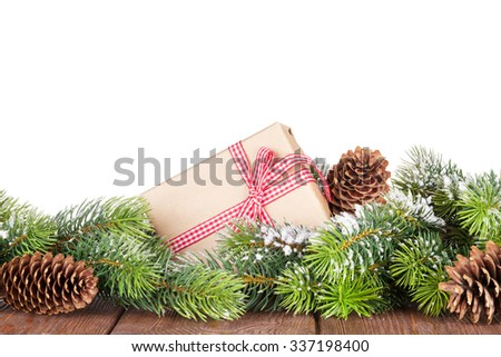 Christmas tree and gift box on wooden table. Isolated on white background - stock photo