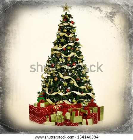 Christmas Tree and Gifts. Over grey vintage background.