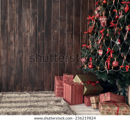 Christmas tree and gifts, place for text - stock photo