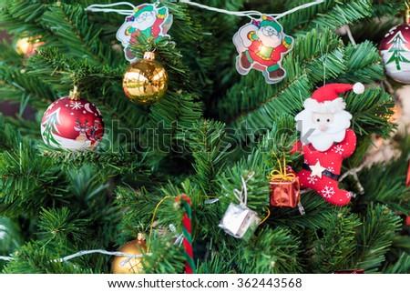 Christmas tree and many decoration dolls  - stock photo