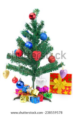 Christmas tree and many present boxes isolate on white background - stock photo