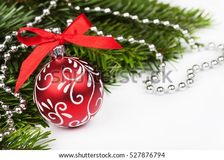 Christmas tree and red ball with red bow on white background.