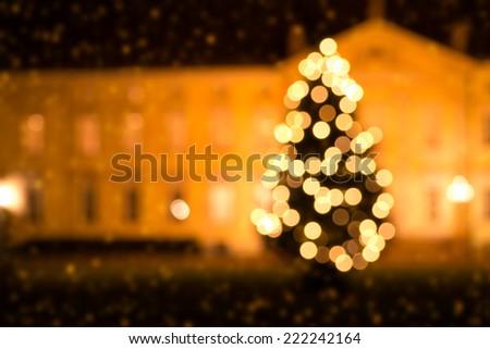 christmas tree and snow (bokeh effect) - stock photo