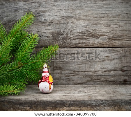 Christmas Tree and toy snowman on wooden background. - stock photo
