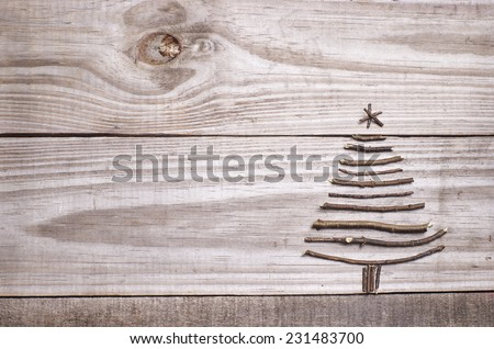 Christmas tree arranged from sticks, twigs, driftwood on grey wooden background - stock photo