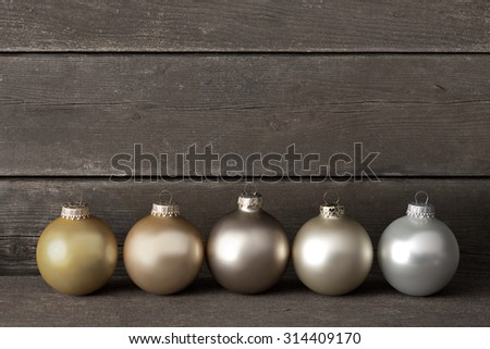 Christmas tree balls in muted colors on dark wood, vintage, retro, filter effect, copy space - stock photo