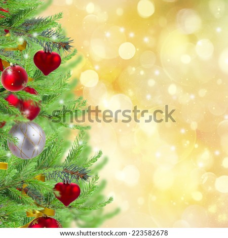 christmas tree border  with decorated fir tree on golden sparkling background - stock photo