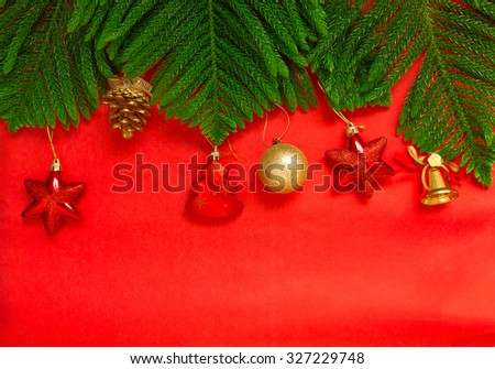 Christmas tree brach and christmas decoration on red background, christmas background - stock photo