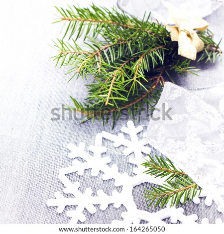 Christmas tree branch and White Christmas decorations on soft grey background. Christmas Time card.  - stock photo