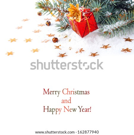 Christmas tree branch with a gift in a red box on a white background isolated - stock photo