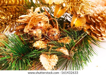 Christmas tree branch with cones closeup image.