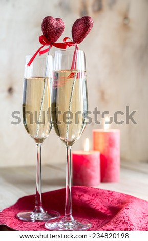 Christmas tree branch with empty champagne glasses - stock photo