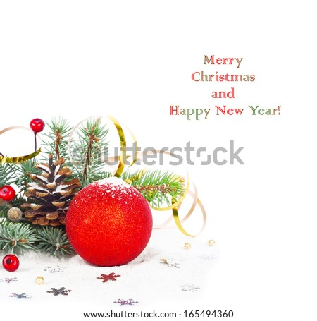 Christmas tree branch with gold serpentine and red sphere on white background isolated - stock photo