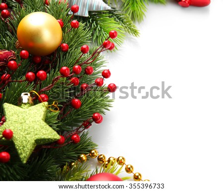 Christmas tree branch with red berries and decorations on white background
