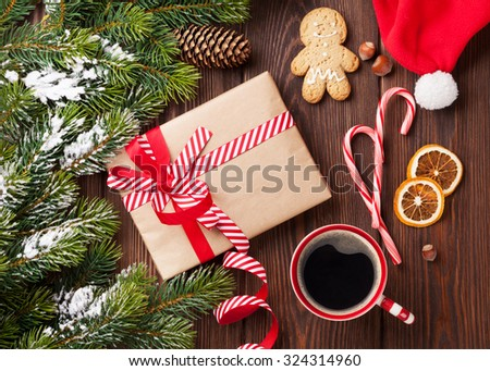 Christmas tree branch with snow and gift box. Top view - stock photo