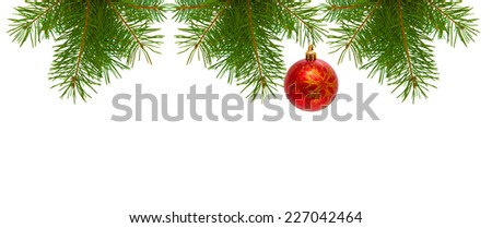Christmas tree branches and Christmas balls. - stock photo