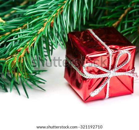 Christmas tree branches border with festive decorations and snowflakes isolated over white background with copy space for text. Holiday festive Xmas card - stock photo