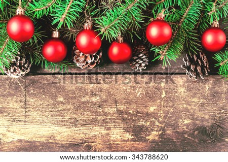 Christmas tree branches on old boards. Christmas background. Christmas decorations. New Year background. Xmax background. Toned image. - stock photo