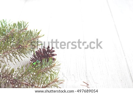 Christmas tree branches on white wood background