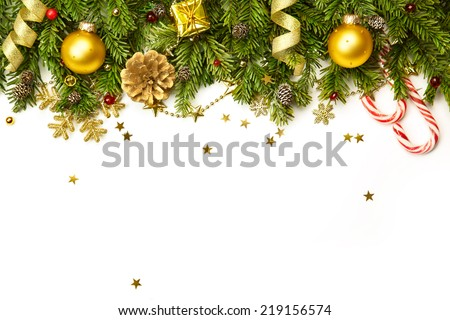 Christmas tree branches with golden baubles, stars, snowflakes isolated on white  -  horizontal border - stock photo