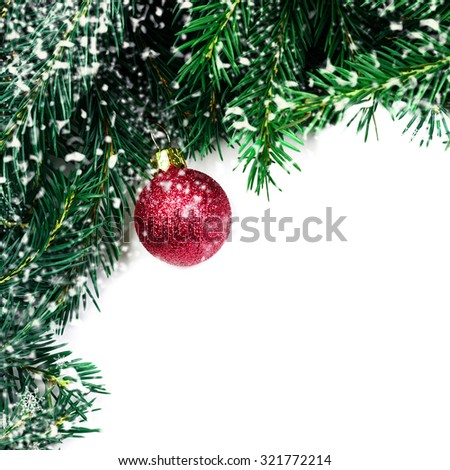 Christmas tree branches with red bauble and snowflakes isolated over white background with copy space for text. Holiday festive Xmas Border. - stock photo