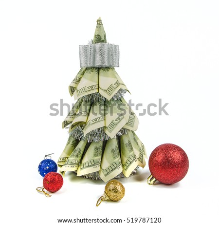 christmas tree by dollars and christmas decorations on white