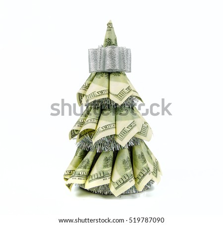 christmas tree by dollars on white background