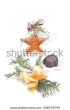 Christmas-tree cake with star bottle - stock photo