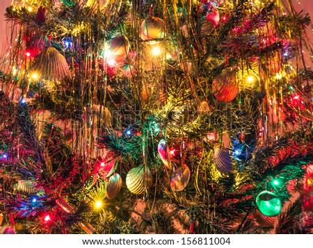 Christmas Tree - Close up of marine Decorations and Lights - stock photo
