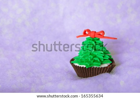 Christmas tree cupcake with white fondant - stock photo