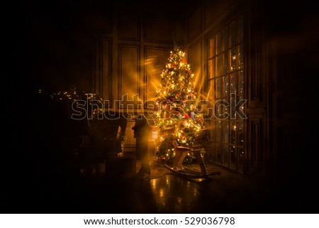 Christmas tree decorated in interior with nutcracker presents and wooden horse lights and vignetting