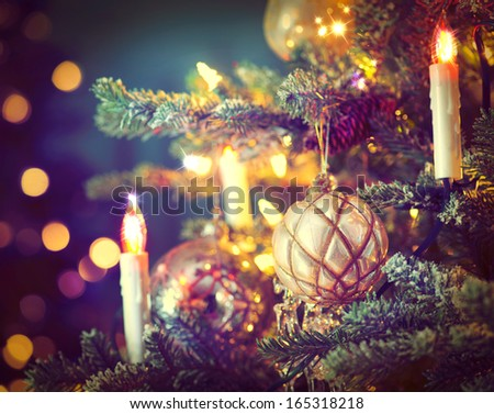 Christmas Tree Decorated with Baubles, Garlands and Candles. Retro Style. Vintage Styled  - stock photo