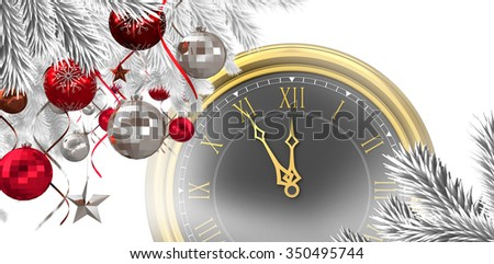 Christmas tree decorated with golden ornaments against large clock