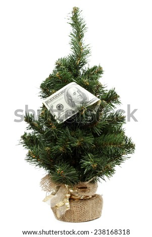 Christmas tree decorated with hundred dollar bills - stock photo