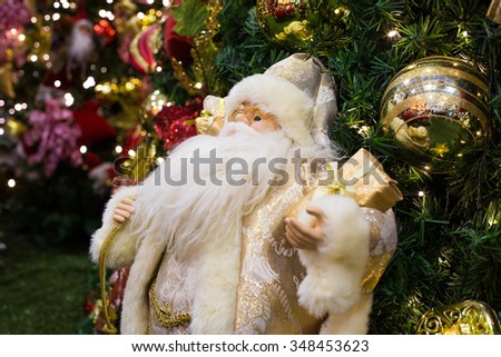 Christmas tree decorated with Santa Claus in the foreground