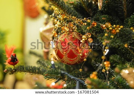 Christmas tree decoration in red- square image with shallow depth of field - stock photo