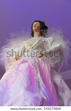 Christmas tree decoration in the form of a figure of an angel - stock photo