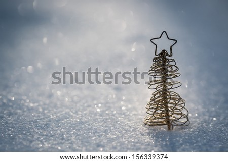Christmas tree decoration on real snow outdoors. Winter holidays concept. Shallow depth of field - stock photo