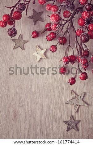 Christmas tree decoration on wooden background - stock photo