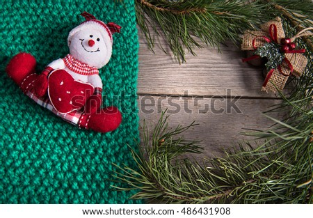Christmas tree decoration snowman wooden texture background woolen warm wear new year green