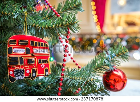 Christmas tree decoration with british red bus - stock photo