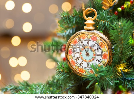 Christmas tree decoration with clock showing five minutes left to new year - stock photo