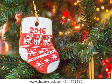 Christmas tree decoration with gingerbread of sock 2016 - stock photo