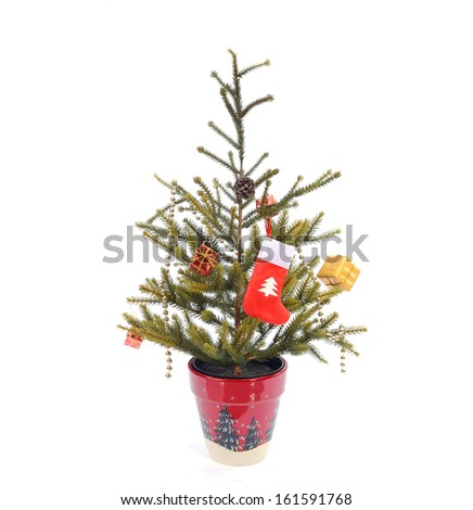 Christmas tree decoration with red pot - stock photo