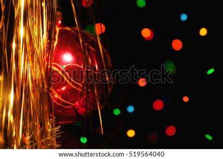 Christmas tree decorations against the backdrop of colorful blurred spots