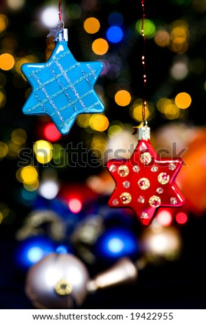 Christmas tree decorations in front of gifts and xmas tree