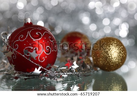 Christmas tree decorations on silver light background - stock photo