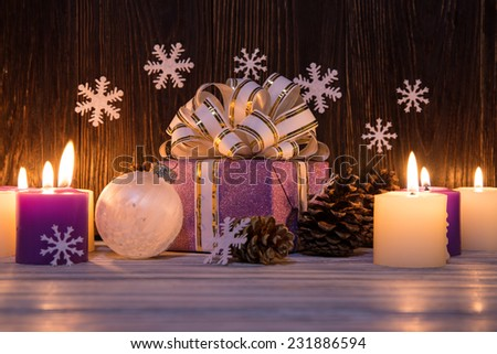 Christmas tree decorations with candles on an old wooden background