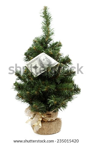 Christmas tree dotted with American dollars - stock photo