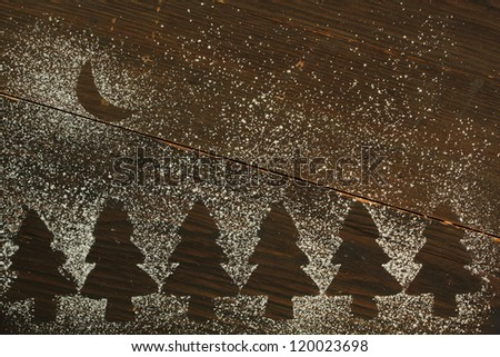 Christmas tree empty space made with sugar powder with a sugar moon shape - stock photo